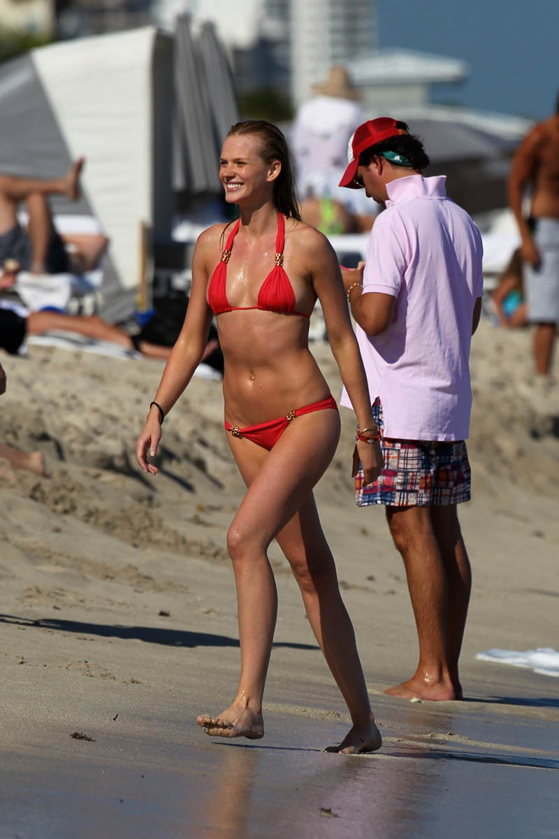 Anne Vyalitsyna in a tiny red bikini at the beach in Miami