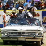 Venezuelan baseball player Miguel Cabrera of Major League Baseball's Detroit Tigers greets fans as he arrives on a car during a ceremony to honor him in Maracaibo