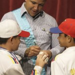 Venezuelan baseball player Miguel Cabrera of Major League Baseball's Detroit Tigers signs autographs for fans after being presented with a regional government award titled