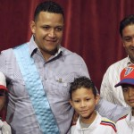 Venezuelan baseball player Cabrera of Major League Baseball's Detroit Tigers poses next to Zulia's state governor Perez and children after being presented with a regional government award titled