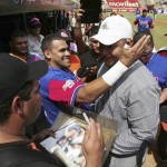 Venezuelan baseball player Cabrera of Major League Baseball's Detroit Tigers greets fans and baseball players during a ceremony to honour him in Maracaibo