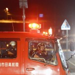 Firefightes persuade residents to evacuate after a strong earthquake hit the area in Rikuzentakata, Iwate prefecture