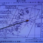 Japan Meteorological Agency's Senior Coordinator for Seismological Information Makoto Saito points to the spot showing the epicentre of a magnitude 7.3 earthquake, during a news conference in Tokyo