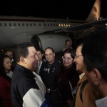 Venezuela's President Hugo Chavez talks to cabinet members upon his arrival from Cuba, at Simon Bolivar airport in Caracas
