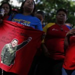 Followers of Venezuelan President Chavez gather to express their support to him and pray for his health at Plaza Bolivar