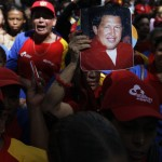 Followers of Venezuela's President Hugo Chavez gather to express their support to him and pray for his health at Plaza Bolivar in Caracas