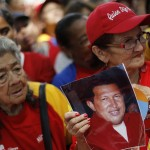 Followers of Venezuela's President Chavez gather to express their support to him and pray for his health at Plaza Bolivar in Caracas