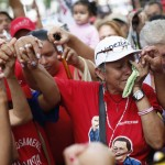 Followers of Venezuelan President Hugo Chavez gather to express their support to him and pray for his health at Plaza Bolivar in Caracas