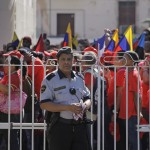 A security guard stands outside Venezuela's embassy as supporters of President Chavez gather to express their support in Havana