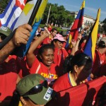 Supporters of Venezuelan President Chavez march towards Venezuela's embassy to express their support in Havana