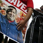Followers of Venezuelan President Chavez gather to express their support to him and pray for his health at Plaza Bolivar in Caracas