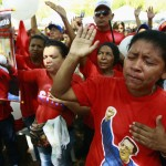 Followers of Venezuelan President Chavez gather to express support to him and pray for his health at Plaza Bolivar in Maracaibo