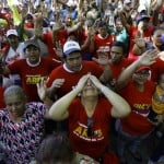 Followers of Venezuelan President Chavez gather to express their support to him and pray for his health at Plaza Bolivar in Maracaibo