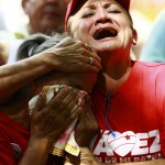 Followers of Venezuelan President Chavez cry as they gather to express their support to him and pray for his health at Plaza Bolivar in Maracaibo
