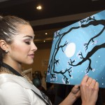 Miss USA 2012, Olivia Culpo, creates a canvas painting for a fundraiser benefiting Cure 4 the Kids Foundation in Las Vegas, Nevada