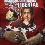 A woman wears a t-shirt with an image of Venezuela's President Hugo Chavez during a mass to pray for his health in Managua