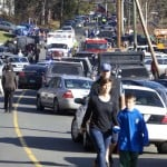 Parents pick-up their children near Sandy Hook Elementary School in Newtown