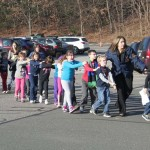 Handout photo of state police personnel leading children from the Sandy Hook elementary school in Newtown