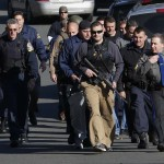 Police patrol the streets outside Sandy Hook Elementary School after a shooting in Newtown, Connecticut,
