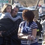 Parents pick-up children outside Sandy Hook Elementary School after a shooting in Newtown