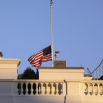 A U.S. flag flies at half staff at the White House in Washington