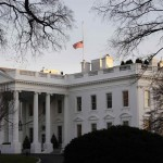 A U.S. flag flies at half-staff at the White House in Washington
