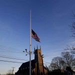 A flag is seen at half staff along Main Street in Newtown, Connecticut