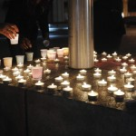 Candles commemorating victims of a Connecticut elementary school shooting burn during a vigil in Oakland