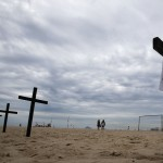 Crosses, in memory of the victims of Sandy Hook Elementary school shooting in U.S., are planted by members of NGO Rio de Paz on Copacabana beach
