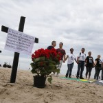 Members of NGO Rio de Paz observe a moment of silence for victims of Sandy Hook Elementary school shooting in U.S., as they stand on Copacabana beach in Rio de Janeiro