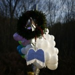 Angel wings are seen at a memorial at the Sandy Hook Elementary School sign in Newtown