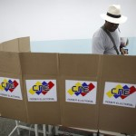 A man casts his ballot during a governors election in Caracas