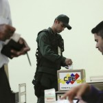 Soldier casts his vote during regional elections in Caracas