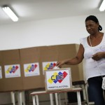 A woman casts her ballot during a governors election in Caracas