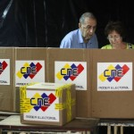 Venezuelans cast their vote during a governors election in Caracas