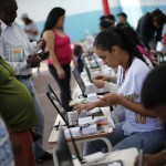 Venezuelans line up to cast their votes during a governors election in Caracas