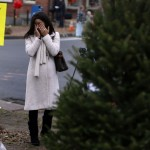 Woman wipes away tears as she pauses at a makeshift memorial near the Sandy Hook Elementary School for the victims of a school shooting in Newtown, Connecticut