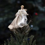 Angel sits atop a Christmas tree left at a makeshift memorial near the Sandy Hook Elementary School for the victims of a school shooting in Newtown, Connecticut