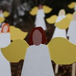 Twenty-seven wooden painted angels created by Eric Mueller are displayed outside his home in Newtown, Connecticut