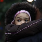 Girl is seen at a memorial near Sandy Hook Elementary School in Newtown