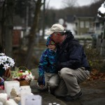Man hugs a boy at a memorial near Sandy Hook Elementary School in Newtown