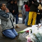 Man prays at a memorial near Sandy Hook Elementary School in Newtown