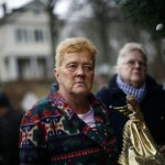 Woman brings a angel doll to a memorial near Sandy Hook Elementary School in Newtown