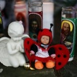 Doll and candles are seen at a memorial near Sandy Hook Elementary School in Newtown