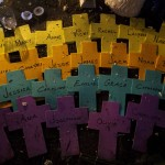 Names of the victims of the shooting at Sandy Hook Elementary School are seen on crosses at a memorial in Newtown
