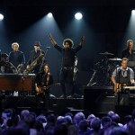 Saxophonist Jake Clemons performs with singer Bruce Springsteen during the