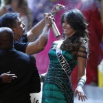 A stylist tends to the hair of Miss Venezuela Irene Sofia Esser Quintero during a commercial break in the Miss Universe pageant at Planet Hollywood Resort and Casino in Las Vegas