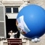 Pope Benedict XVI leads his Angelus prayer from window of his private apartment in Saint Peter's Square at the Vatican