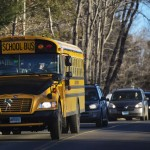 A school bus carrying children from Sandy Hook Elementary School makes its way to their new school in Monroe as they leave Newtown