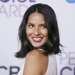 Actress Olivia Munn arrives at the 2013 People's Choice Awards in Los Angeles